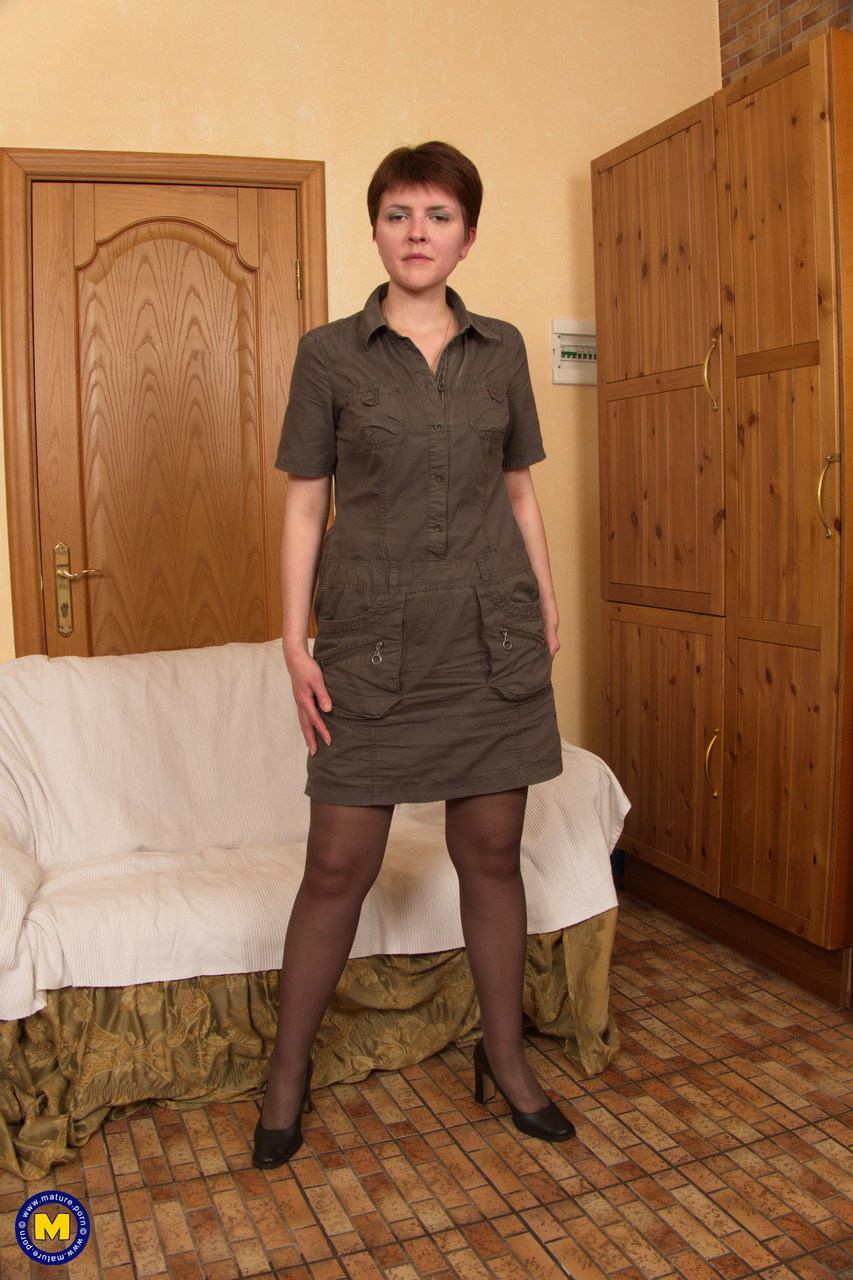 mature woman in pantyhose with small saggy boobs spreading her ass