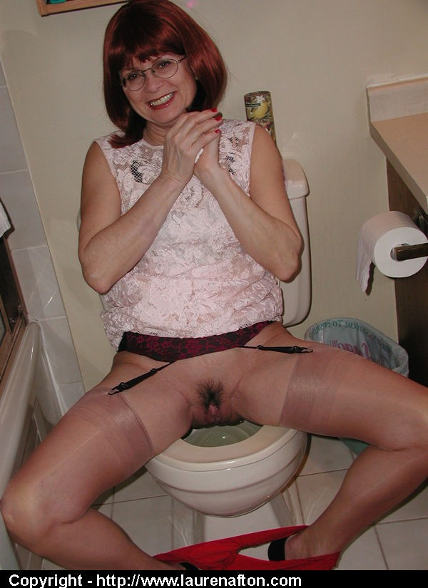 ... Mature mom Miss Abigail shows her hairy pussy while pissing on the  toilet ...
