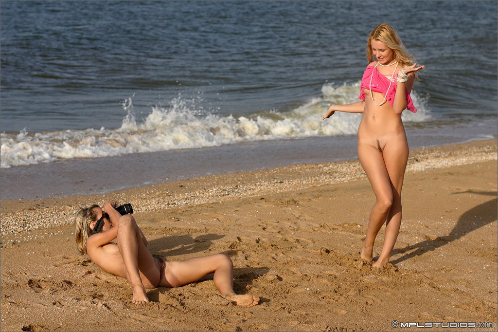 Small titted hot blonde girls having fun taking naked photos at the beach