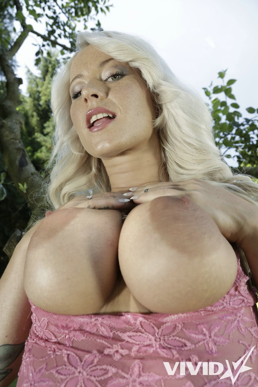 Sexy blonde Nicky Lex strips outdoors showing huge nipples and spread vagina