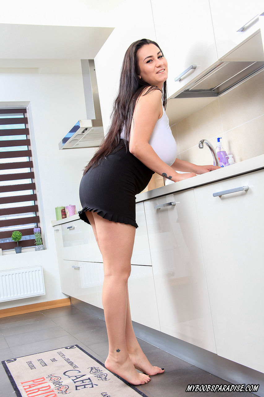Chubby model Helen Star whips out her massive tits in the kitchen