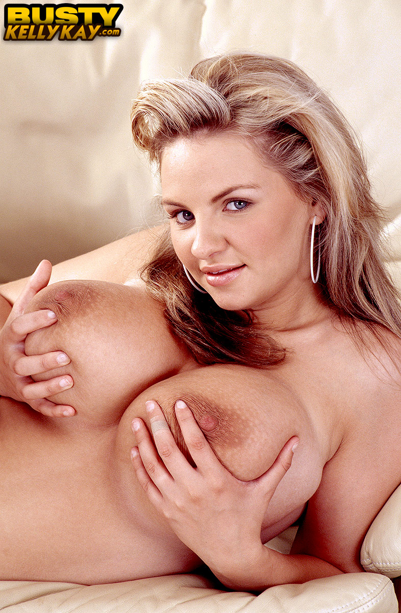 Solo model Kelly Kay plays with the nipples attached to her hooters
