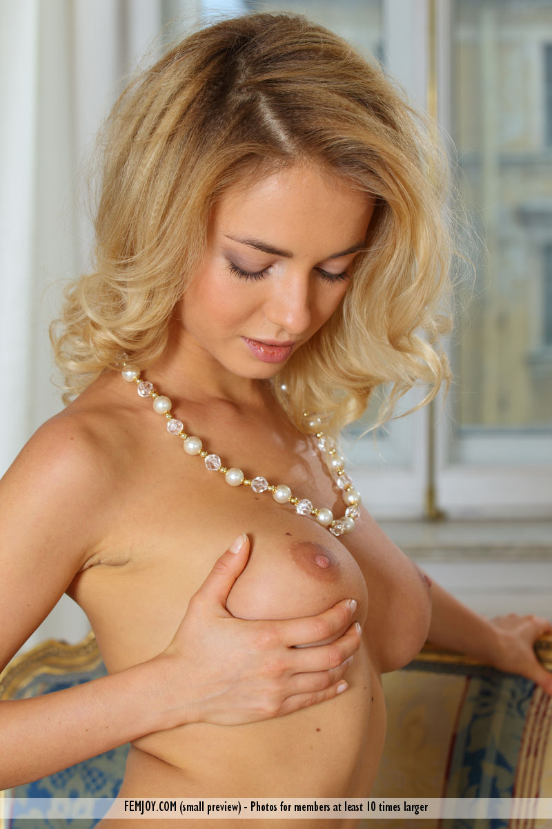 Petite blond Annabell models completely naked with a high degree of confidence
