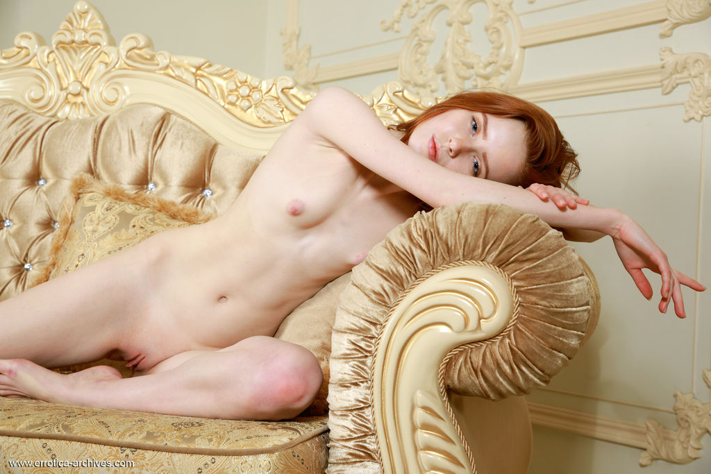 Pale redhead Bella Milano unveils not only her bald twat but her tight ass too