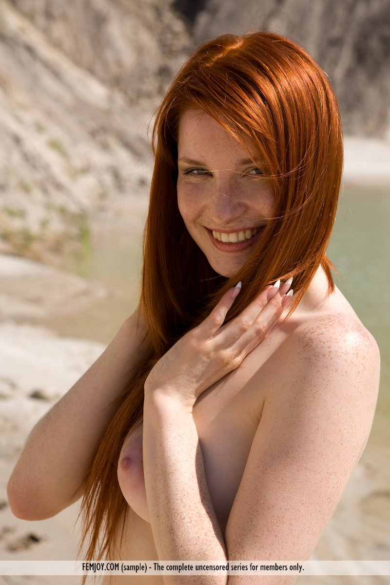 ... Pale redhead Rosalia strikes sexy solo poses in the nude on a sandy  beach ...