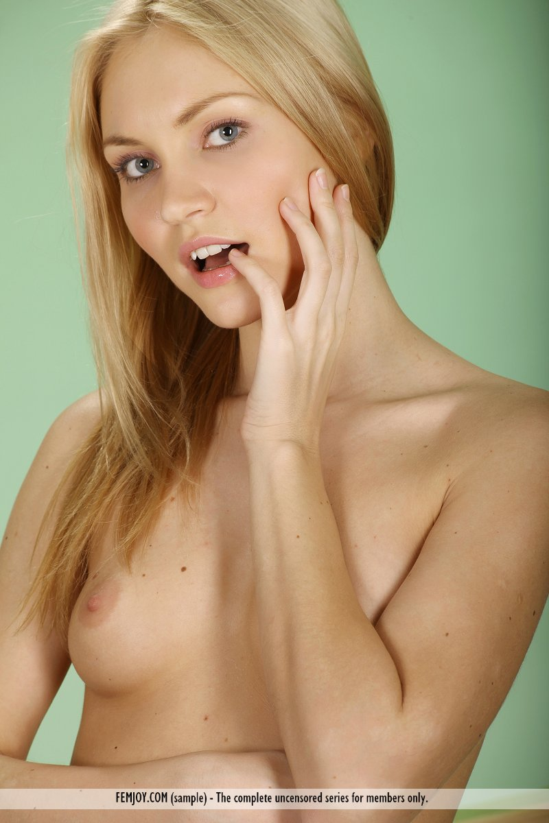 Beautiful blonde chick Kristy wears no clothes while posing in the nude