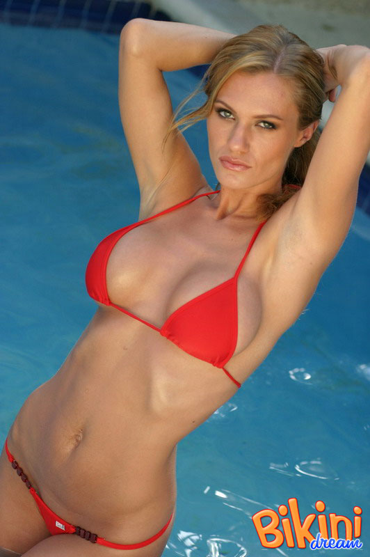Stunning bikini model Daniella goes topless at the pool