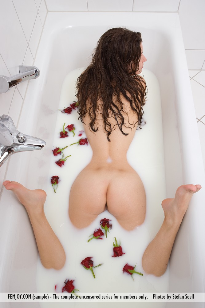 Sweet sexy brunette Susann with her big tits  hot ass floating in bubble bath