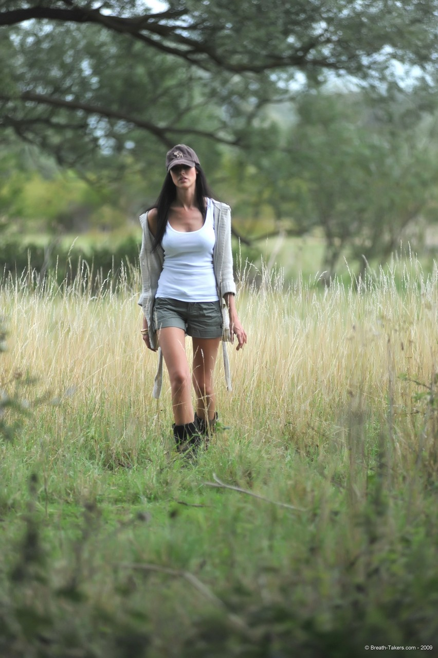 Seductive brunette Bailey strips off in the woods to pose in panties  boots