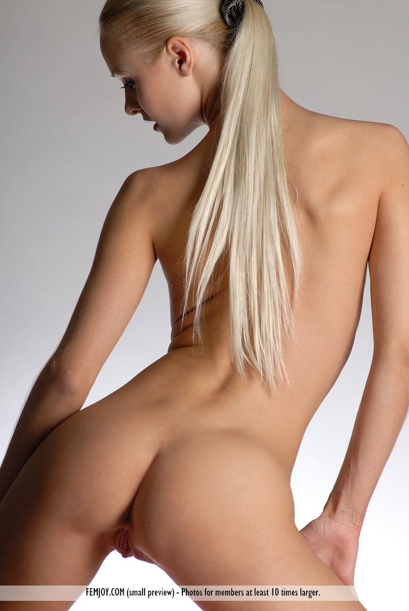Long legged hot blonde Vika poses nude on her knees to flaunt small hot ass