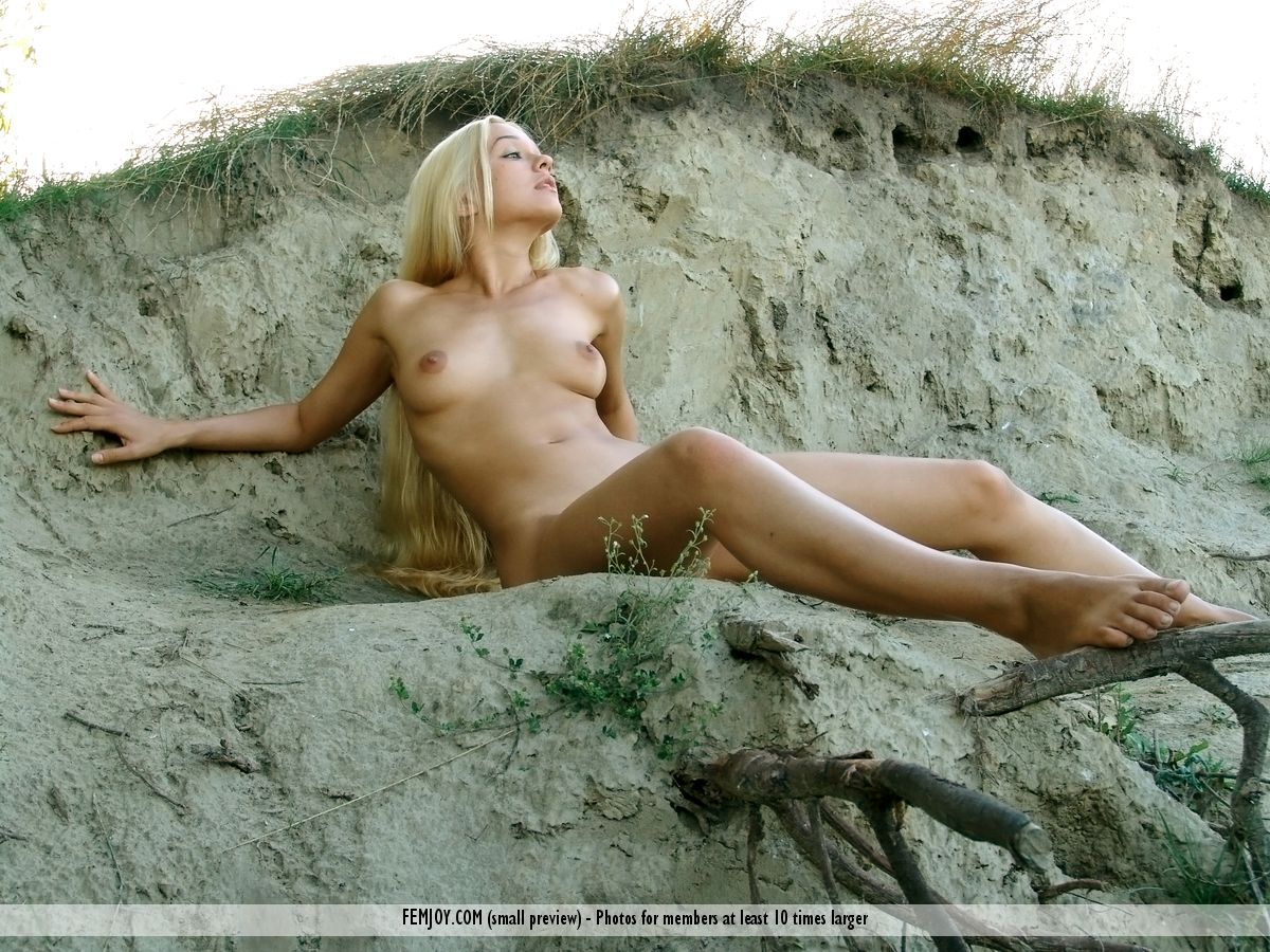 Blonde beauty Desiree frolics naked in the sand enjoying beach sunset