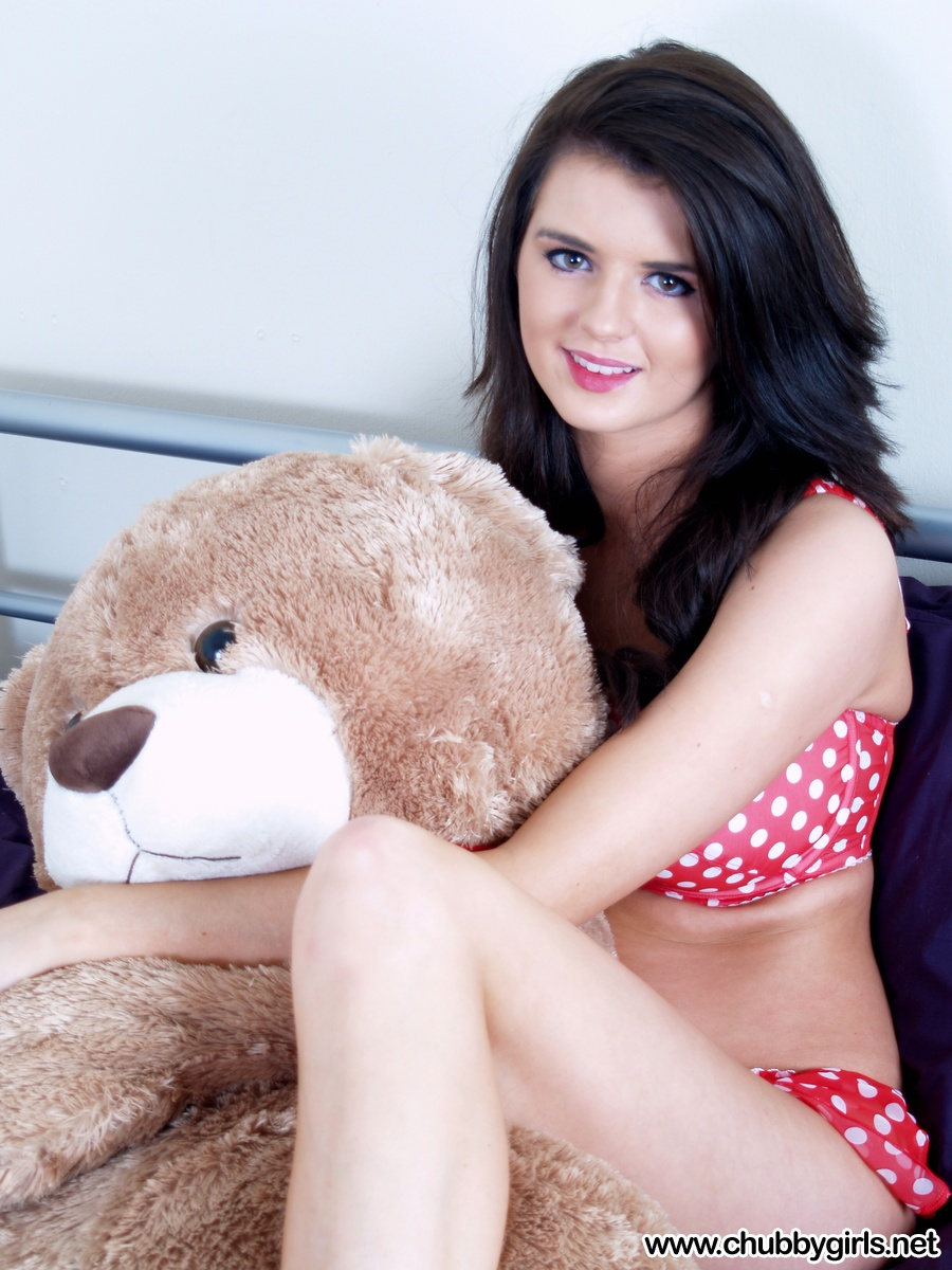 Brunette chick lets go of her stuffed bear to expose her big natural tits