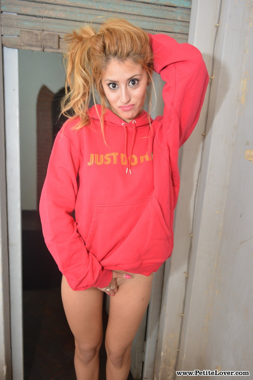 Delicious redhead babe in a hoodie Mika flashes her goodies