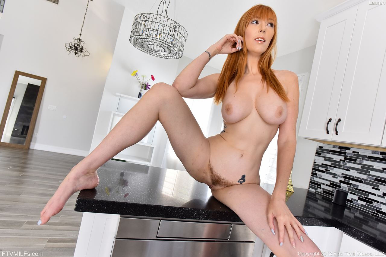 Sexy redhead chick exposes her nice tits and hairy ginger pussy