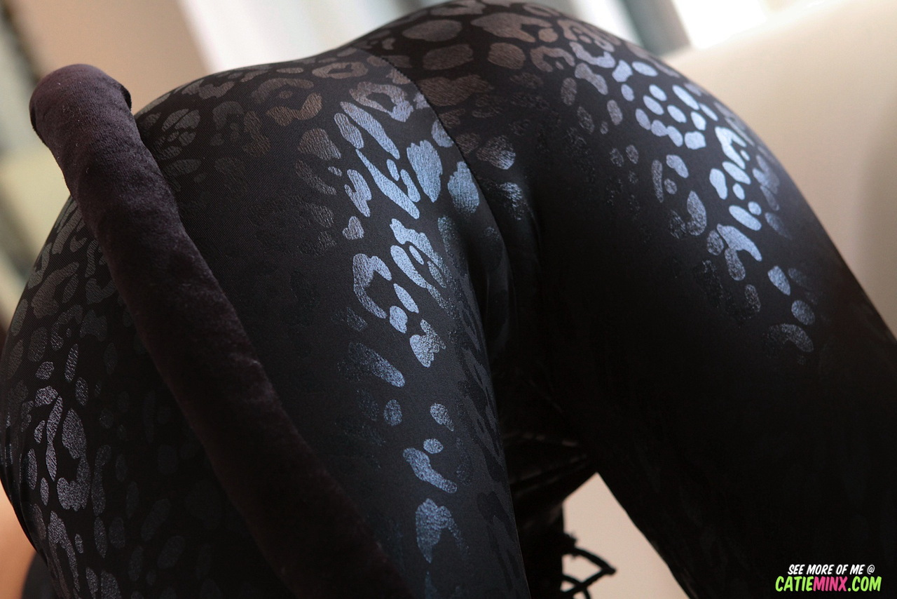 Solo girl Catie Minx shows off her bald pussy attired in a catsuit
