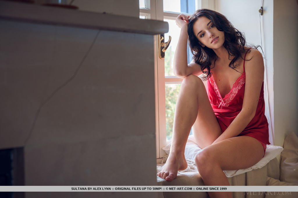 Pretty Sultana undressing in the window  spreading for shaved closeup