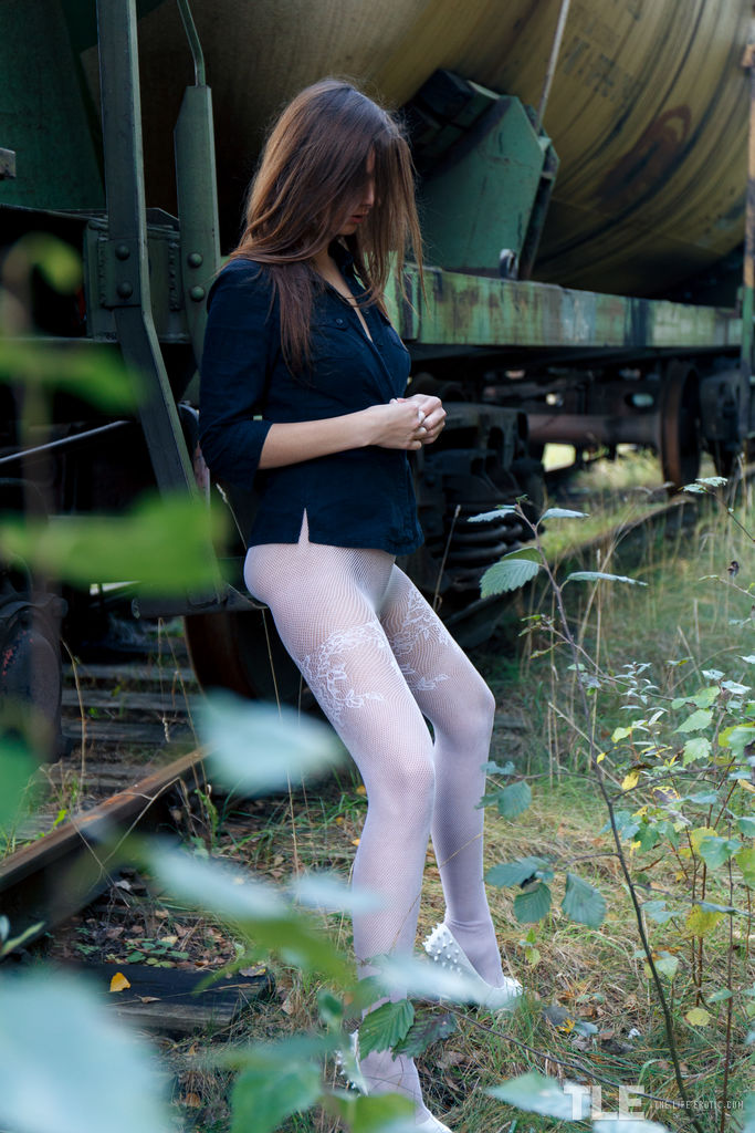 Brunette in pantyhose Rebeka Ruby toys herself while taking a piss outdoors
