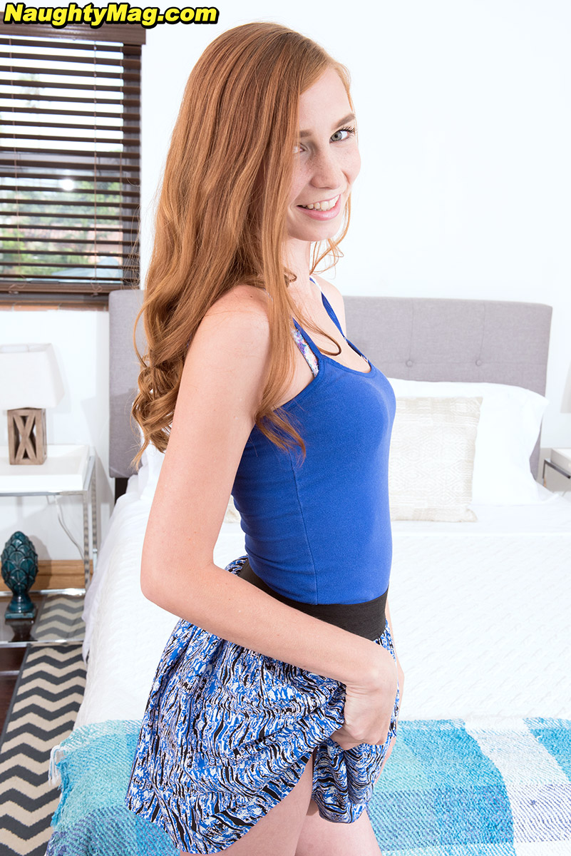 Cute redhead Ava Parker removes her short skirt to pose in sexy underwear