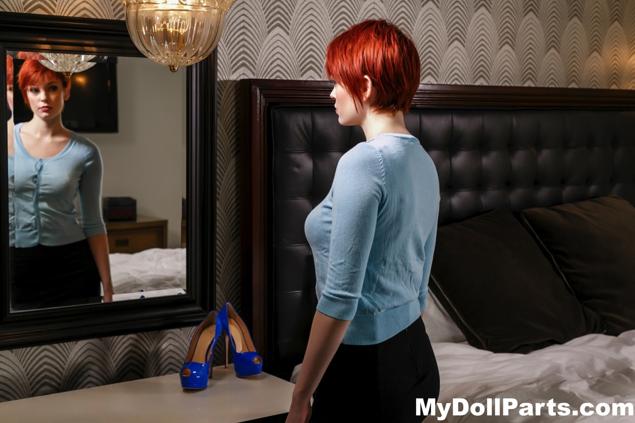 Hot redhead Bree Daniels shows nice tits & sexy feet while changing lingerie