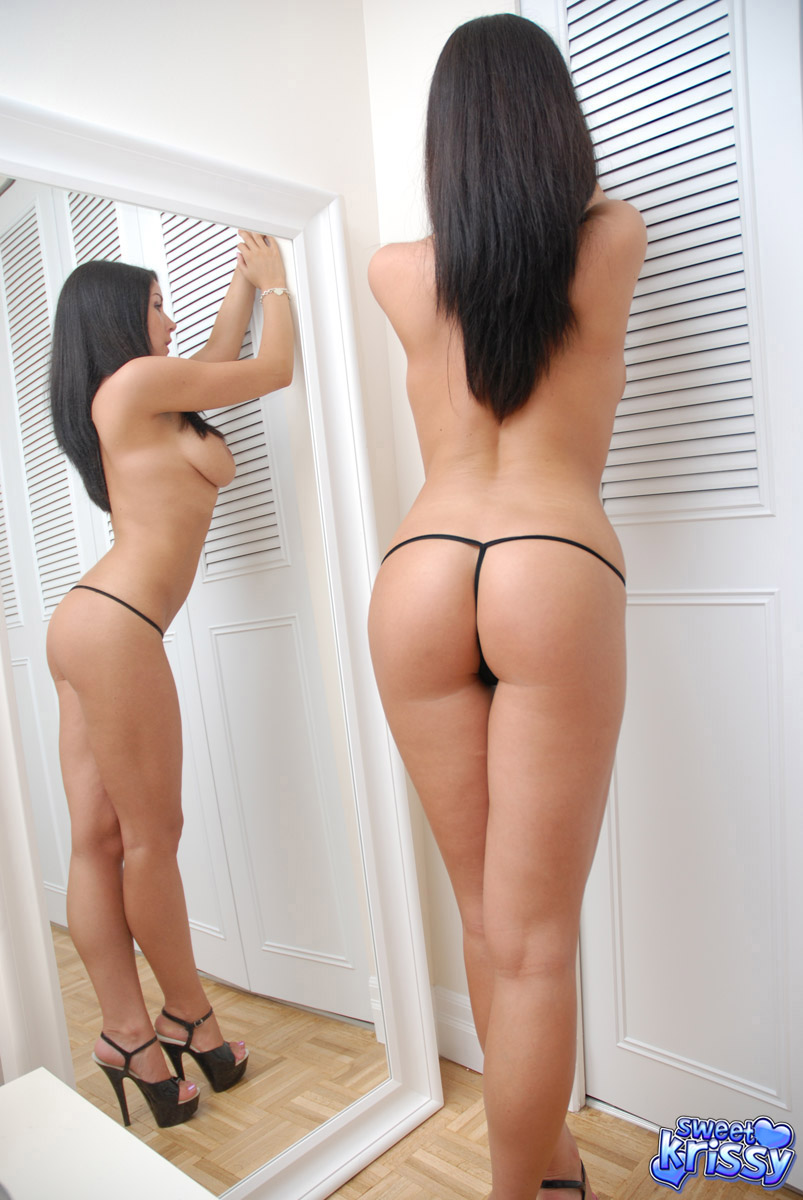 Dark haired amateur flaunts her tight butt in a black thong