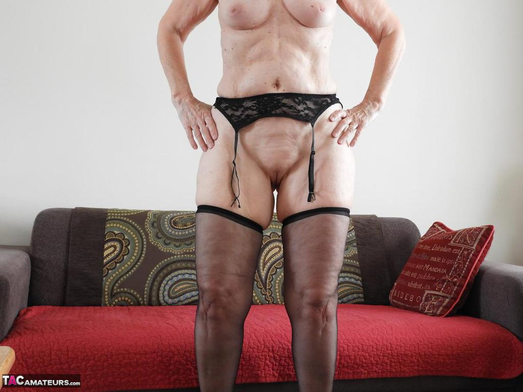 Horny mature granny Kat Kitty removes sheer lingerie to ...