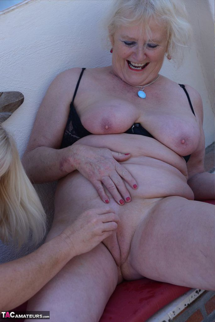 Fantastic MILF with amazing tits Melody fingering a horny grannys pussy