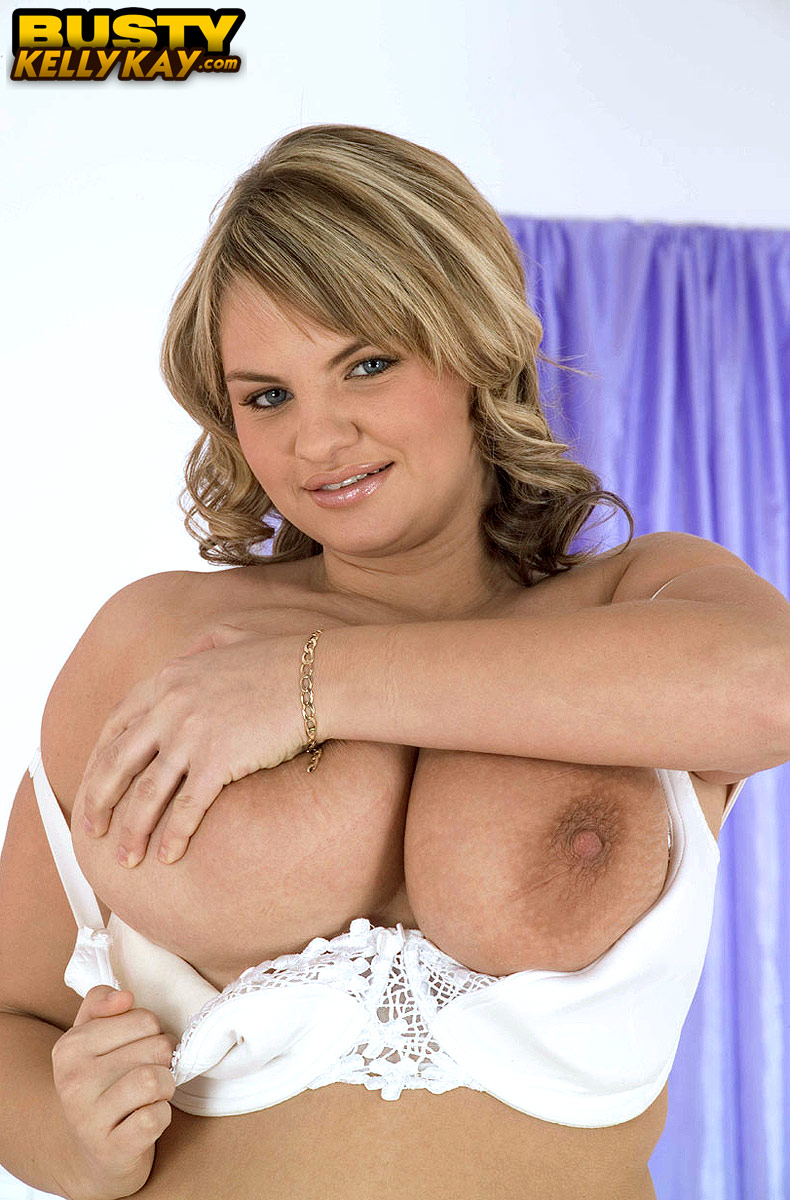 Thick woman Kelly Kay wraps her giant boobs around a sex toy after undressing