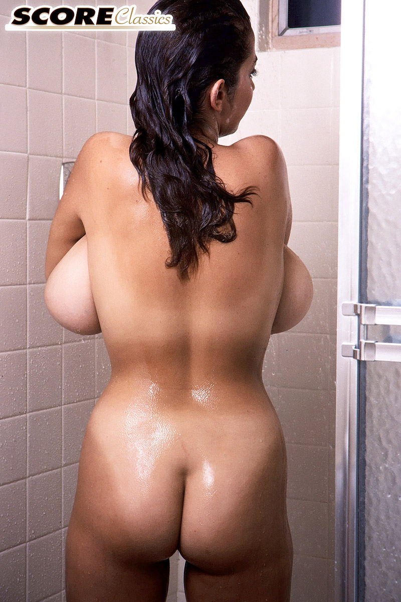Solo girl Devon Daniels gets wet while unleashing massive tits in shower