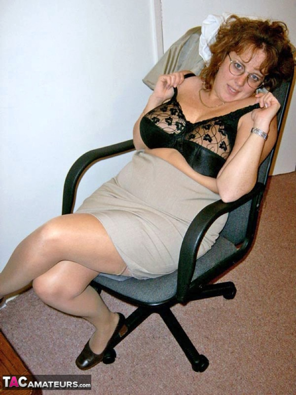 Mature redhead Curvyclaire dons thigh high boots after stripping to lingerie