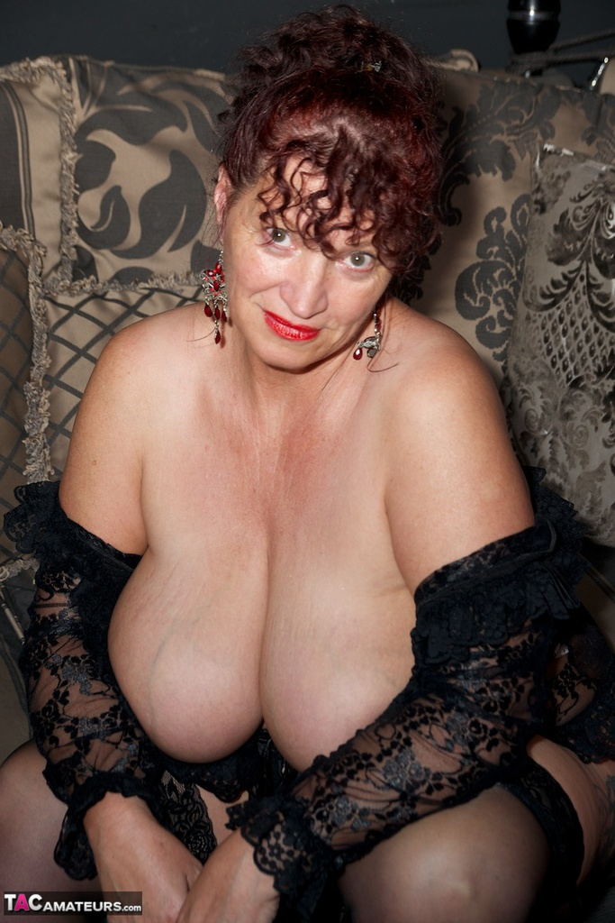 Beautiful mature in sheer lace lingerie poses with her massive saggy tits out
