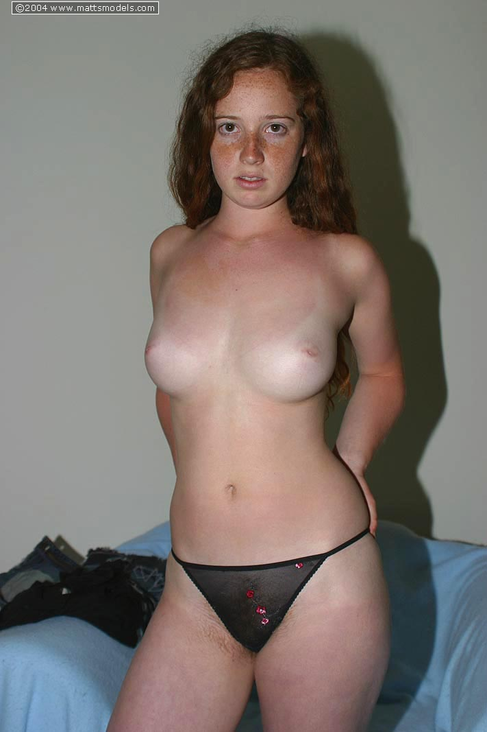 Redhead with freckles and big tits parts her natural pussy after getting naked