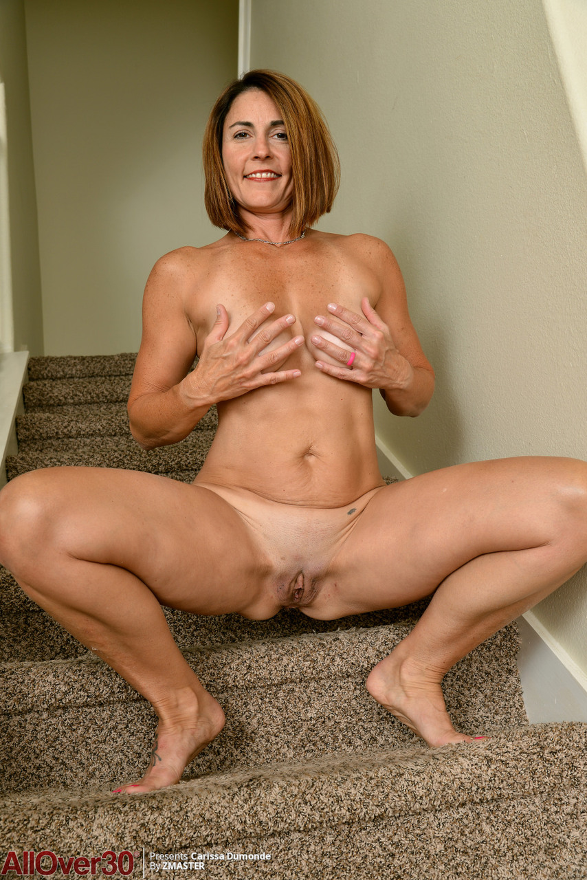 Mature mom Carissa Dumonde lets her big boobs sag free  spreads her ass wide