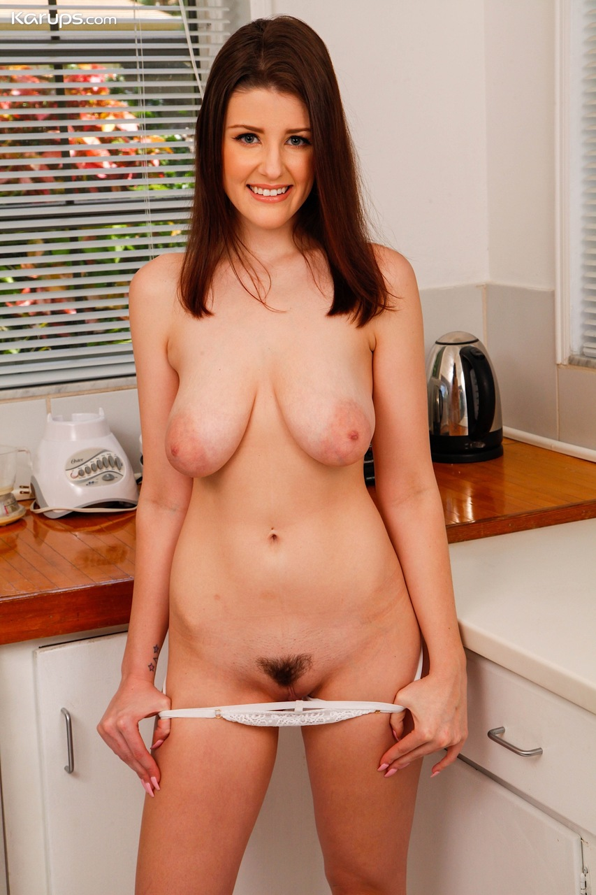 Busty brunette amateur Michele James sticks a toy up her snatch in the kitchen