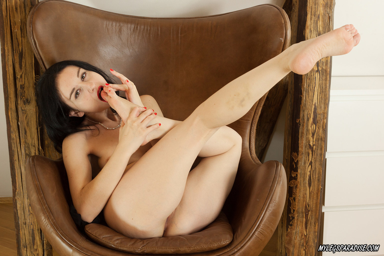 Beautiful dark haired Amy Aziri removes black pantyhose to lick sexy bare feet