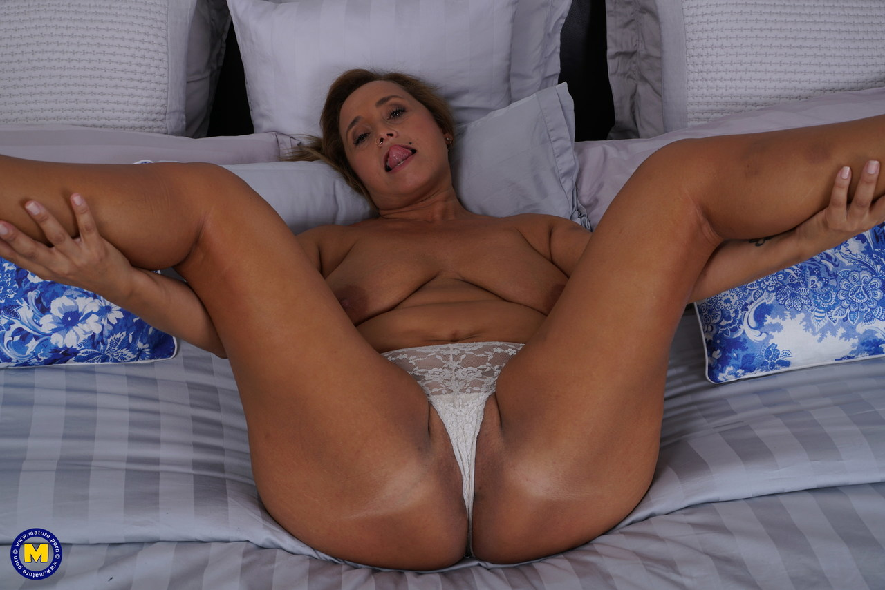 Naughty Housewife Conchita Strips And Fingers Her Mature Spanish Pussy In Bed