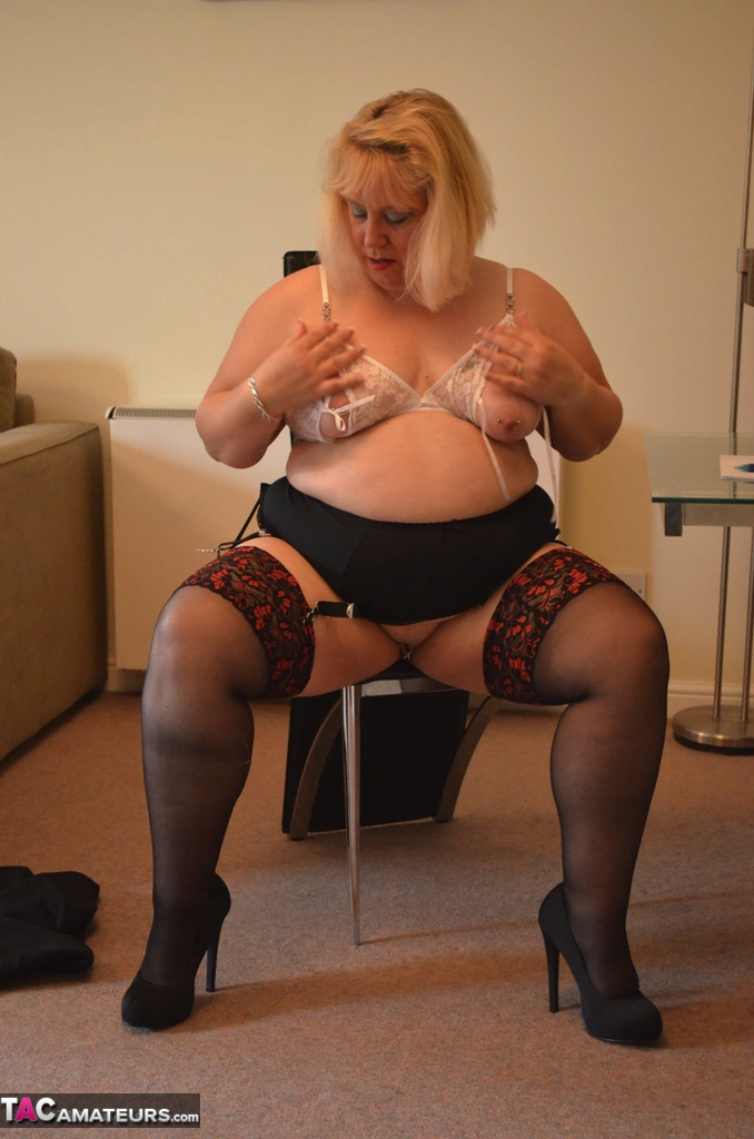 Mature blonde BBW Lexie Cummings strips to her stockings and masturbates