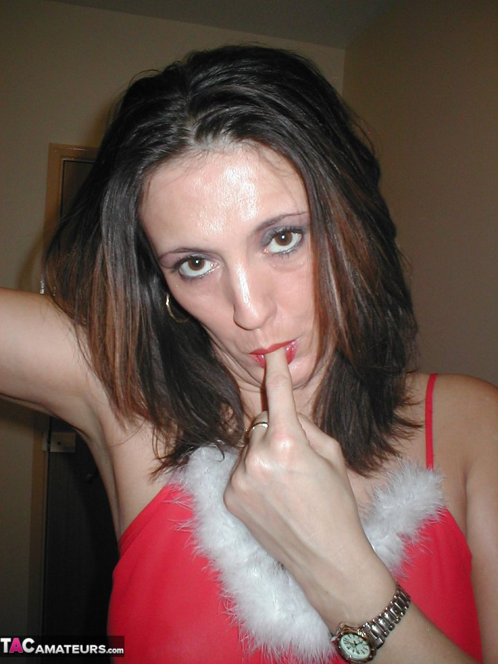 Amateur woman Juicy Jo pauses for a smoke while taking off her Xmas outfit