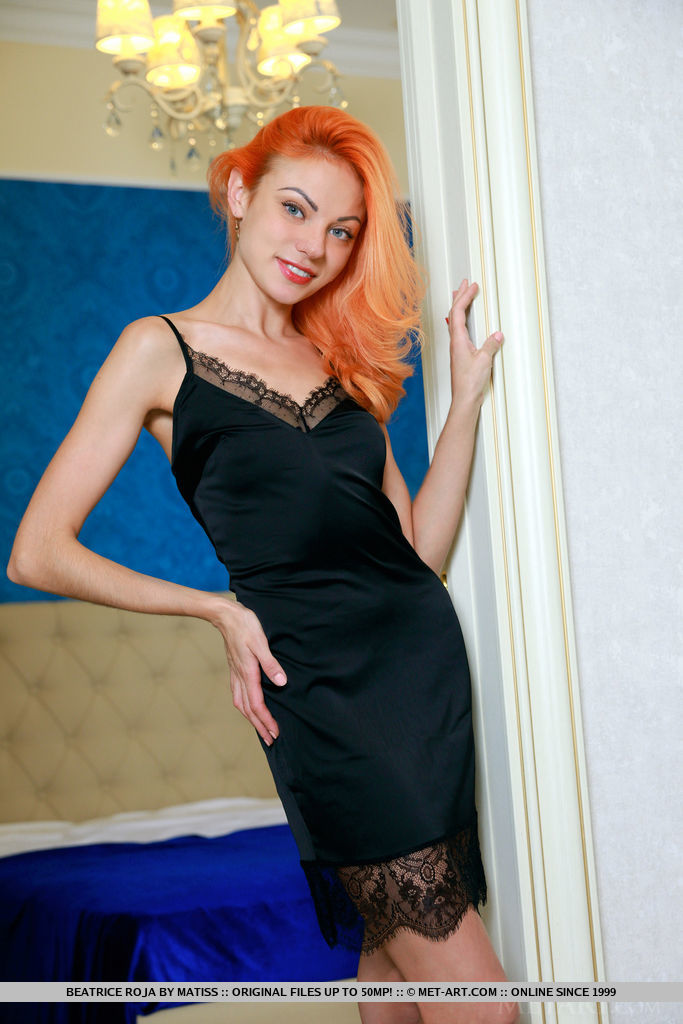 Pale redhead Beatrice Roja sets her slender figure free of black lingerie