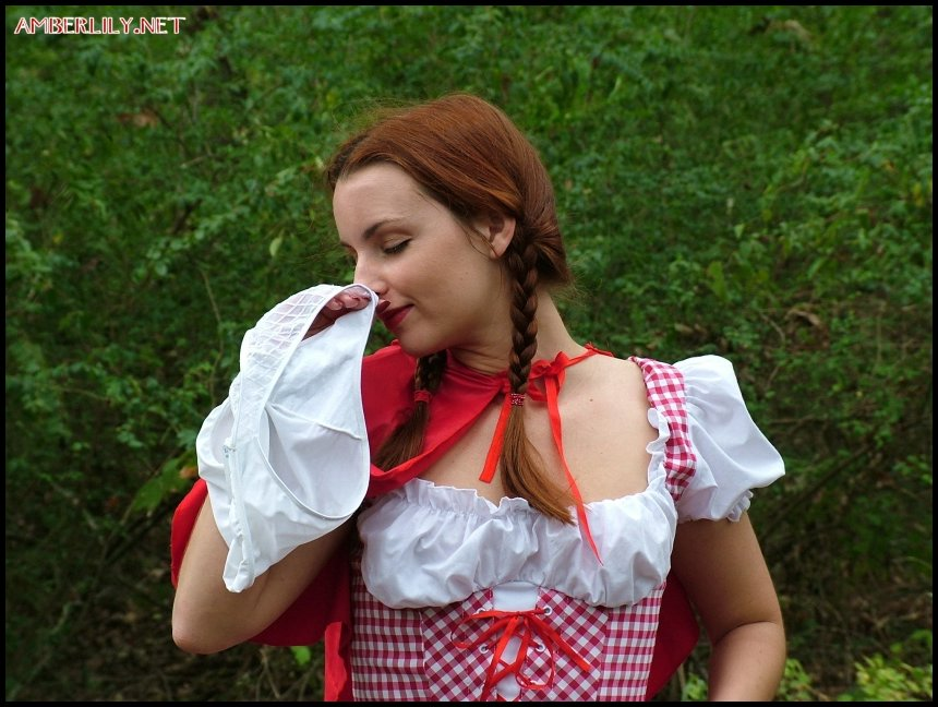 Amateur girl Amber Lily frees tits and twat from Little Red Riding Hood outfit