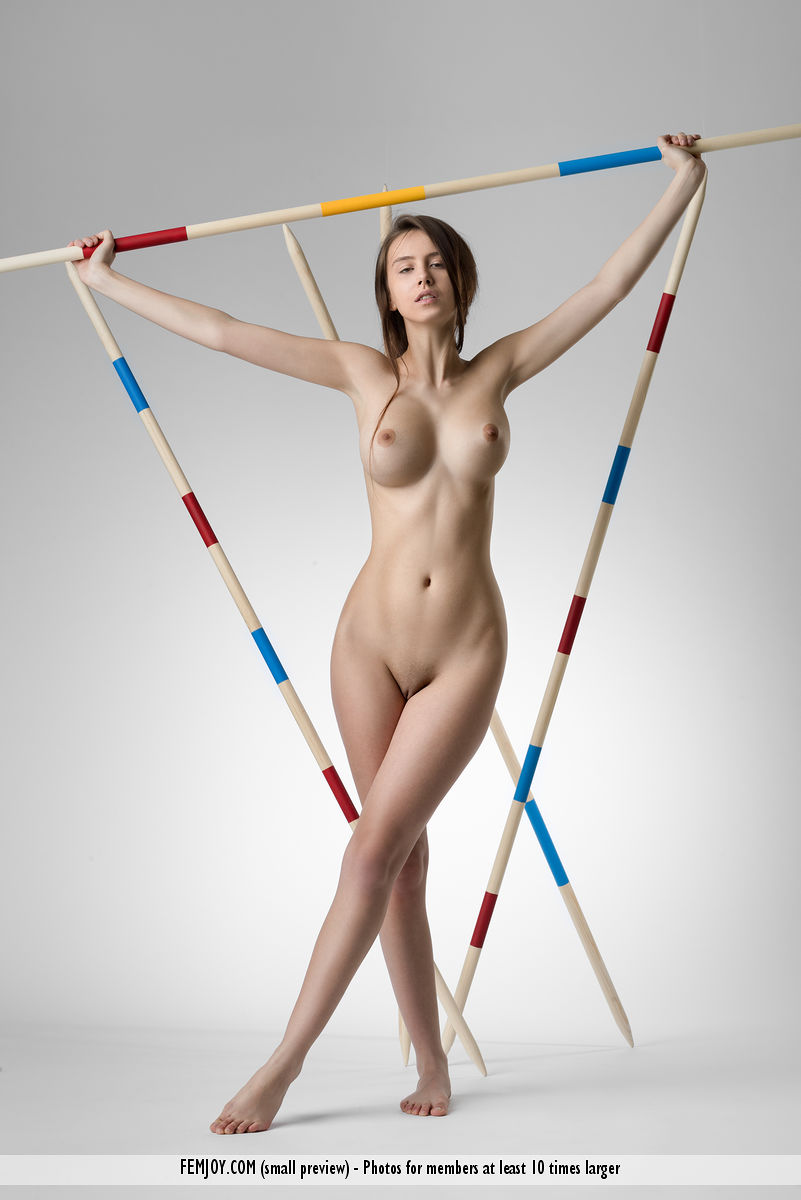 Totally naked teen Alisa I shows her beautiful body amid pointy poles