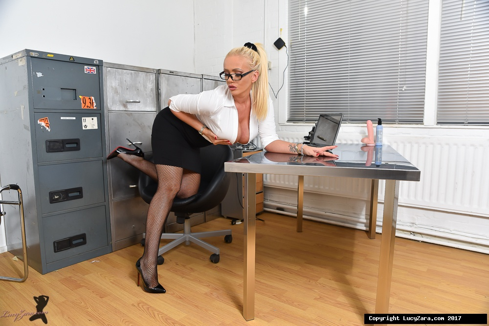 Hot blonde secretary Lucy Zara strips to nylons before dildo play in office