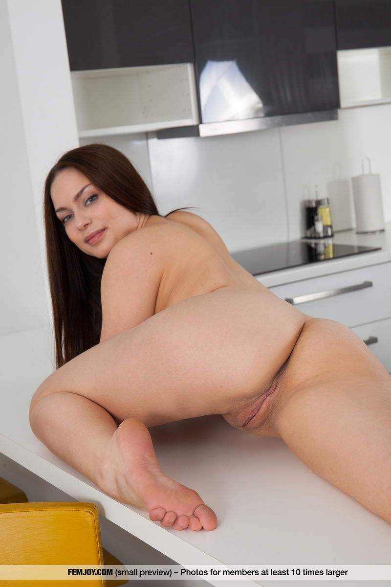 Sexy brunette Emma V frees her beautiful body from sheer robe to pose nude