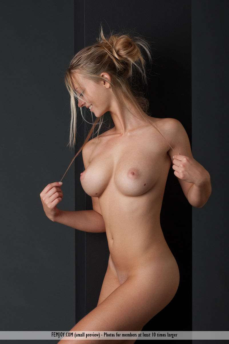 Beautiful girl Carisha holds her nice boobs while modelling naked