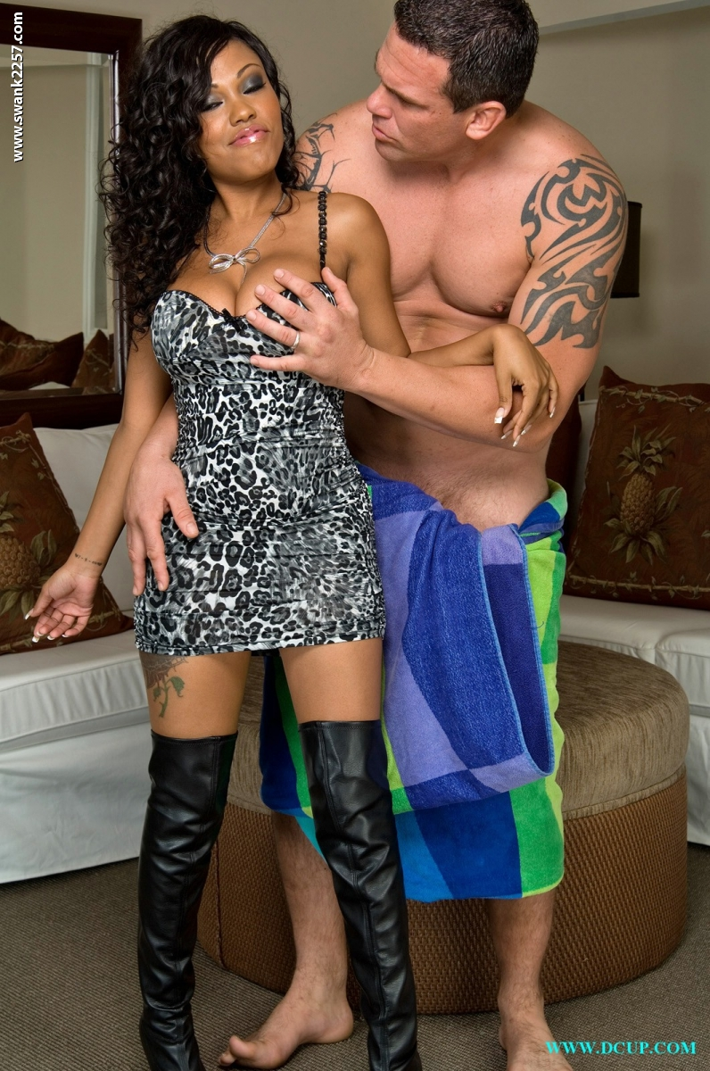 Busty ebony chick Lacy Duvalle takes a cumshot on ass after sex in OTK boots