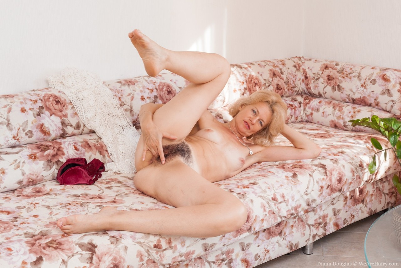 Mature lady Diana Douglas parts her hairy bush in her nude ...