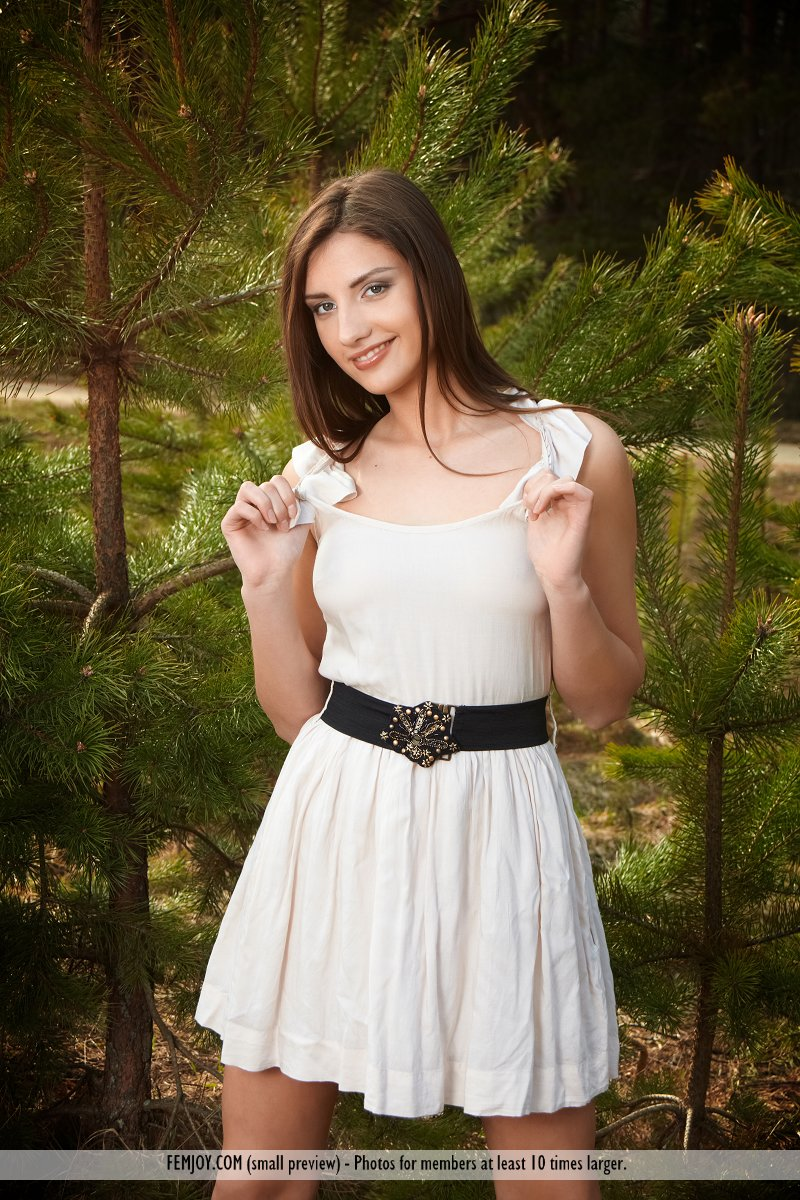 Nice teen Alisee D stands naked in the woods after removing white dress