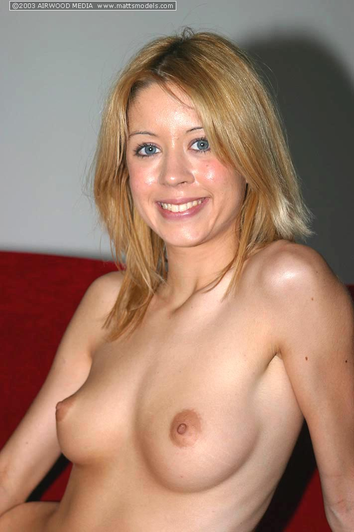 Blonde amateur Fiona removes lace panties to model completely naked