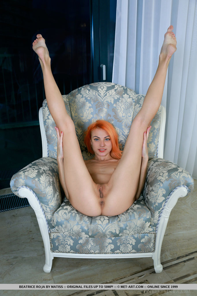 Orange haired Beatrice Roja spreading long legs super wide to show nice pussy