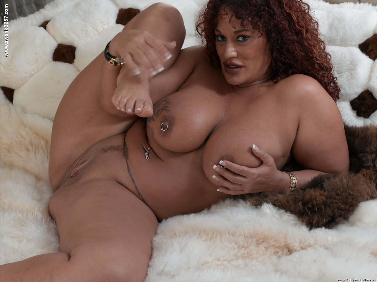 Hugely busty mature woman bares tattooed big tits  toys pussy with dildo
