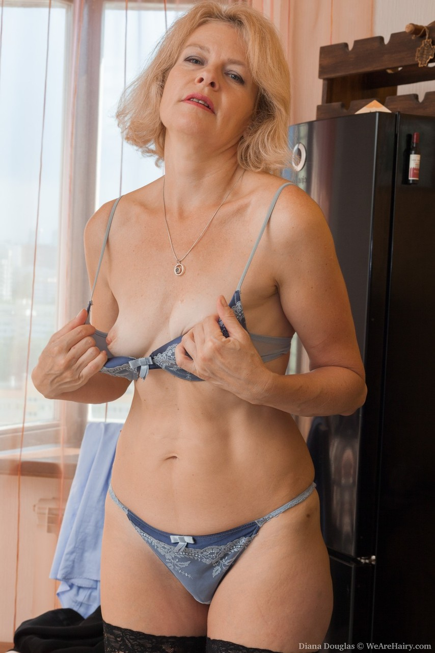 ... Mature lady with blonde hair Diana Douglas stretches out her hairy  snatch ...
